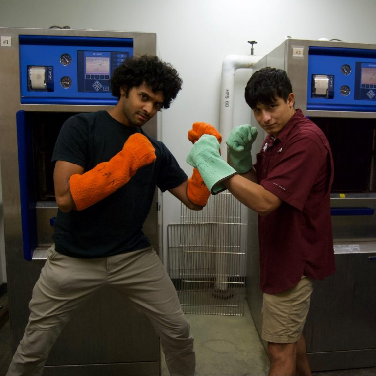 MDTP students Daven Khana and Julio Rivera-Vazquez take autoclave duties very seriously.